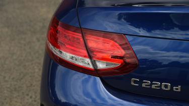 Range Rover Evoque Convertible vs Mercedes C-Class Cabriolet - C-Class badge