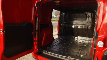 The load area is equipped with a 12 volt power socket and loading light.