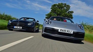 Porsche 911 Cabriolet vs Mercedes-AMG GT Roadster - header