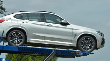 New BMW X4 spied uncovered side