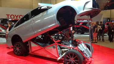 Taking the award for most shocking has to be this mad Camry dragster. The body looks like any other mid-sized, conventional and conservative Camry but jack up the front and hinge the body back, the inside reveals a completely different