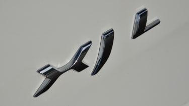 Jaguar XJ L badge