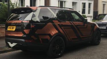 Land Rover Discovery 2017 - spy shot orange rear quarter