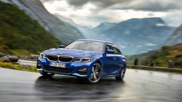 BMW 3 Series - blue cornering