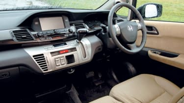 Wood trim axed in spacious cabin.