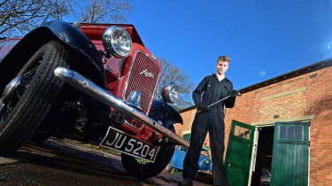 Student next to classic car