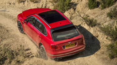 Bentley Bentayga luxury SUV offroad hill rear