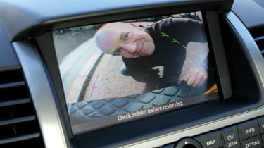 The reversing aid provides a live feed from the lens to the monitor in the dash. Guides on the monitor help the driver position the car, while the on-screen warning is an ever-present reminder that the system has to be used with cautio