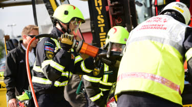 Fire crew road accident preparations heavy cutter