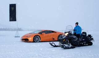 Lamborghini Huracan vs snowmobile