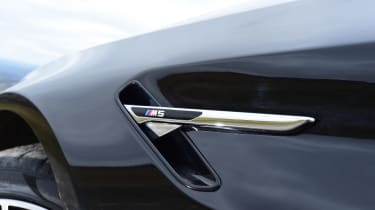 BMW wing M5 badge