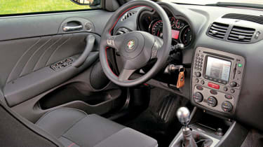 Red stitching on leather seats and wheel adds sporty touch to the cabin