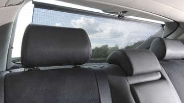 Parcel shelf incorporates a retractable blind, which is handy in bright sunshine