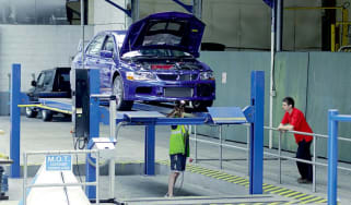 Mitsubishi Lancer Evo IX in workshop