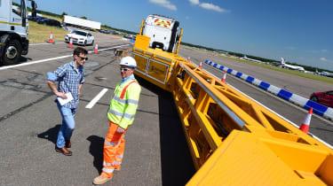 Road worker road barrier truck