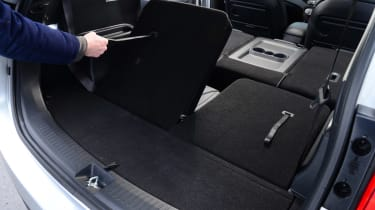 The rearmost seats fold easily into the floor. They're not very roomy and are best for occasional use.
