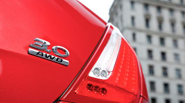 Jaguar XJ AWD badge