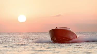 Aston Martin AM37S boat - front sunset