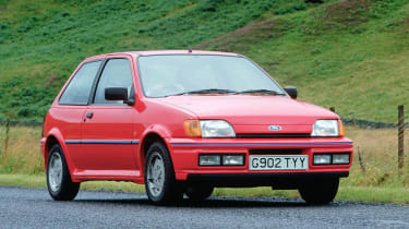Ford pursued the 'just add lightness' theme with the lively XR2i. At around 850kg it had an impressive power to weight ratio of 121bhp per tonne.