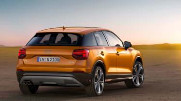 Audi Q2 orange rear side