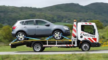 Flatbed van brokendown car