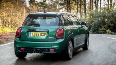 The current car has moved further away from the ethos of the original but the Mini DNA is still plain to see.