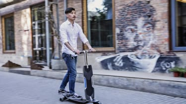 Audi Connected Mobility longboard guy
