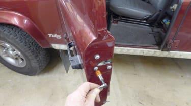 Defender door latch replacement - 1