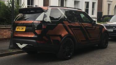 Land Rover Discovery 2017 - spy shot orange rear quarter 2