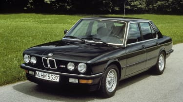 "The <a href=""/bmw/m5"">M5</a> brand was born in auspicious style as the hot version of the E28 5 Series took its bow at the 1984 Amsterdam Motor Show to wild speculation over what exactly BMW had been smoking.