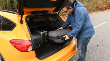 Ford Focus ST Estate: long-term test review - first report - John loading luggage in boot