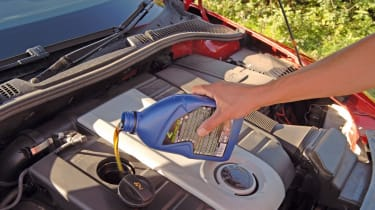Slowly pour oil into the engine and check the dipstick every so often to avoid overfilling