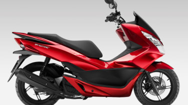 Honda PCX 125 review - red side profile static