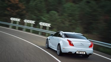 Jaguar XJ driving - rear
