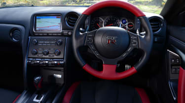 The interior does lack the finesse and quality of a coupe in the same range.