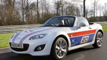 "The MX-5 celebrated its 20<sup>th</sup> year in production in predictable style with another special edition. The MX-5 20<sup>th</sup> Anniversary Edition had Recaro bucket seats, 17"" 10-spoke wheels and was a range of highly questiona"