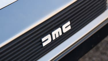 DMC DeLorean - DMC badge