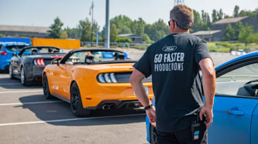 Queue of Ford Mustang and Focus RS