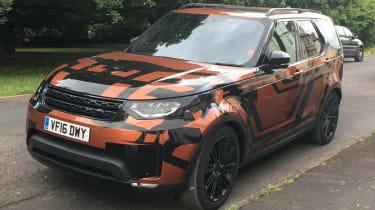Land Rover Discovery 2017 - spy shot orange front quarter