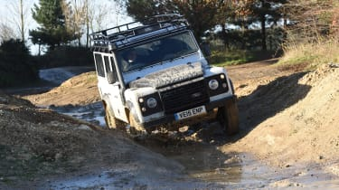 Land Rover Defender vs Toyota Land Cruiser - Defender front off road