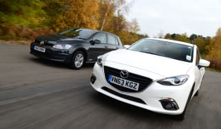 Volkswagen Golf vs Mazda 3 2013 main