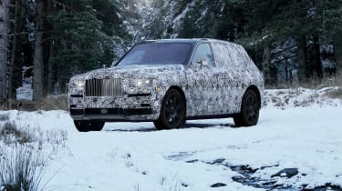Rolls Royce Cullinan side snow