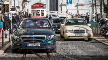 Mercedes E-Class - front driving town