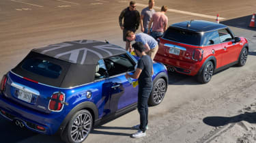 MINI Convertible blue and red parked