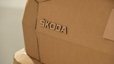 Cardboard Skoda Karoq rear badge