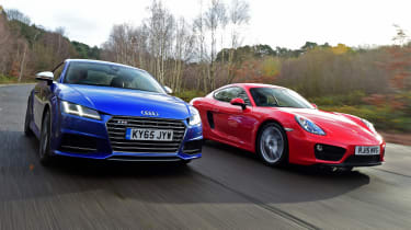 Used Porsche Cayman vs New Audi TTS - front driving