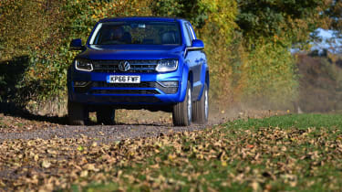 Volkswagen Amarok pick-up 2016 - driving leaves