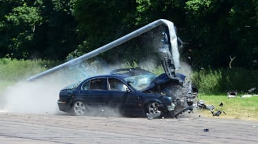 Car crash into lamp post