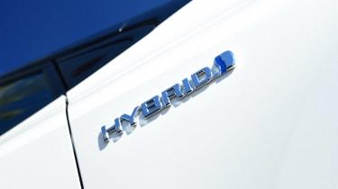 Toyota Corolla - Hybrid badge