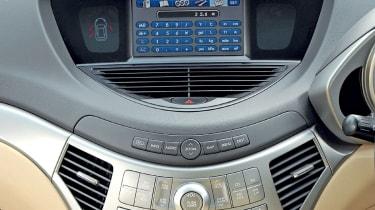 Smart silver centre console dominates the cockpit